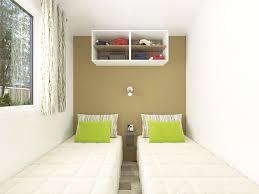 Le mobile home Malaga au camping en Dordogne Périgord Noir dispose de 2 chambres, une chambre adulte avec un lit double et une chambre enfants avec deux lits simples
